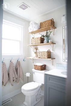 Handmade Home Bathroom. Gray Vanity. Penny Tile. Open Shelving. Turkish Towels.