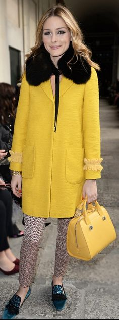 Who made Olivia Palermo's yellow coat, blue loafer shoes, handbag, and print pants?