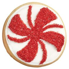 Best of the Season Spiral Candy Cookies - Ready-to-use Cookie Icing is available in lots of holiday colors! Here  we've used red and white icing and a sprinkle of red colored sugar  to jazz up a simple round cookie.