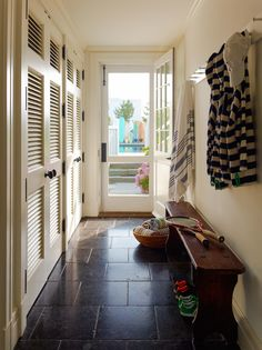 Blue Laundry Room And Mudroom Cabinets Transitional . Interior Design Inspiration Photos By Evars And Anderson . Built In Mudroom Bench With Gray Seat Cushion . Home and Family Entry Hallway, Entryway, Entry Tile, Hallway Closet, Garage Entry, Front Entry, Closet Space, Mudroom, Decoration