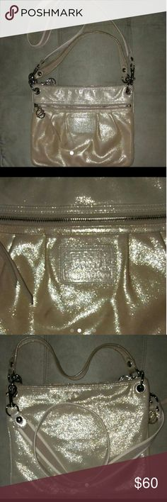 Stunning Shimmery Coach Poppy Gorgeous golden shimmer messenger or hobo. This is a re-posh with permission..Breaks my heart that I need a bigger bag. Great condition and authentic. Small smudge, can barely be seen. Long strap included, and removable. Versatile as a hobo or crossbody. Love tjis. Pics do not do it justice! ?? Adk for any details. Coach Bags Crossbody Bags