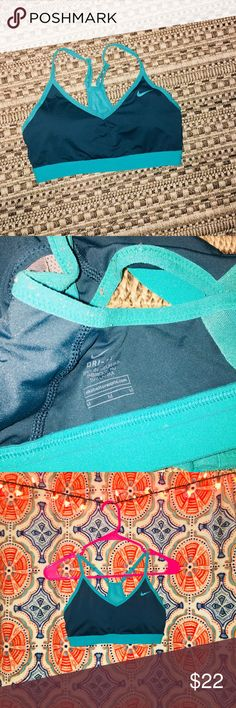 Nike Indy sports bra Great condition. Women's size medium. Beautiful navy blue and teal colored. Originally $45. Only worn a few times and never worn during a workout lol Nike Intimates & Sleepwear Bras