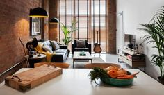 Kate Koumi has turned a blocky brick industrial unit in Fulham, bought in 1995 to use as a sound recording studio, into two flexible warehouse apartments, designed to convert to one house when required.