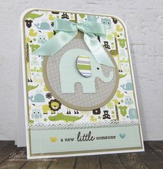 handmade greeting card ... A new little someone by lotsofstamps - at Splitcoaststampers ... die cut elephant .. fun patterned paper with critters ...