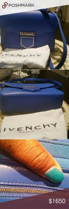 Givenchy nobile calfskin leather 100% authentic,in mint condition. Is a Christmas gift from hubby not really my style.it has adjustable strap, magnetic snap tab closure,gold tone hardware, I zipper pocket and designer plague. Inside is in excellent condition,it comes with a dust bag....measurement reads  L 9.8× H 5.2 × W 2.8. Givenchy Bags Totes