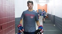 When Jesperi Kotkaniemi stepped on the ice Wednesday night, he became a small piece of NHL history. The Montreal forward became the first p. Montreal Canadiens, Max Domi, Hockey Players, Sports News, Cute Guys, Nhl, History, Mens Tops, How To Make