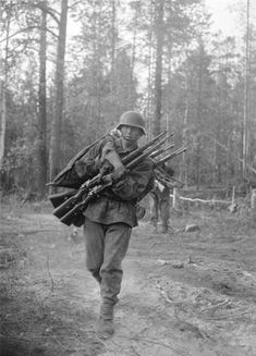"Soldier of SS division ""Nord"" carries carbines of dead or wounded colleagues, july 1941 - pin by Paolo Marzioli"