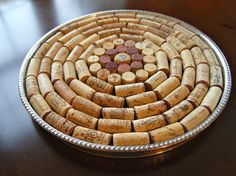 This is a rather large trivet measuring about 13 across. Its just the right size for a large casserole dish. The wine corks are placed inside a round silver tray in a fun circular pattern.    Place between a serving dish or bowl, and a dining table, to protect the table from heat damage. A great dinner party conversation piece, house warming gift or just a pretty addition to any table scape. Thanks for stopping by!    A-Rae    http://aileenrae.blogspot.com/