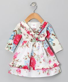As prim as the roses decorating its print, this dress is the perfect pick for Baby's day out. Long sleeves and cozy cotton make it as comfy as it is charming. 100% cottonMachine wash, tumble dryMade in the USA