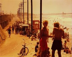 """THEN //Circa 1971. Vans and trucks pulled right up to the sand. Oil wells  still pumping right along the old service road that once was the Pacific  Electric right of way. If some radios are blaring, they're probably playing  """"Brown Sugar,"""" """"Maggie May"""" and """"I Feel the Earth Move""""—among other hits of  the day. Smack in the deep bronze haze of summer, you can almost smell the  cocoa butter and coconut oil from the Coppertone. Downtown, the Golden Be..."""