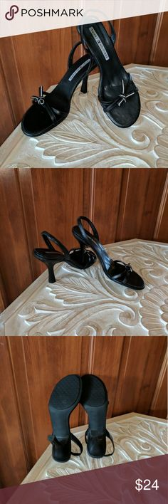 Tommy Hilfiger Heeled Slingback Sandal in Black Excellent condition!  Tommy Hilfiger brand heeled slingback sandals.  Black leather with cute black and white bow detail on forefoot.  Ready for a fun summer's night.  Questions welcome. Tommy Hilfiger Shoes Sandals