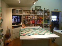 Quilting room.   Love this. So clean and uncluttered and big tv, too!