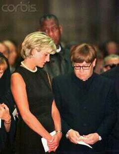 July 22, 1997: Diana, Princess of Wales next to Sir Elton John at a Memorial Service for Italian stylist Gianni Versace in the Milan Cathedral.