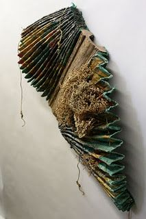 Inventive book structure; http://ctartscene.blogspot.com/2010/05/friday-evening-opening-of-book-arts.html