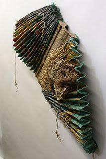 Inventive book structure; http://ctartscene.blogspot.com/2010/05/friday-evening-opening-of-book-arts.html