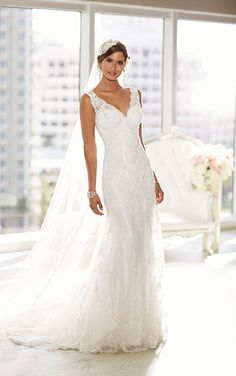 Elegant, sheath Lace and Lavish Satin wedding gown from the Essense of Australia designer collection features a vintage-inspired Lace overlay.