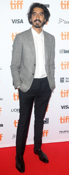 Celebrating the premiere of Lion at Toronto Film Festival in Toronto, British actor Dev Patel wearing Burberry tailoring