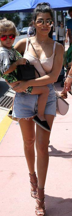Kourtney Kardashian: Sunglasses – Victoria Beckham Collection  Purse – Givenchy  Shorts – Levi's  Shoes – Alaia  Bracelet  – Cartier