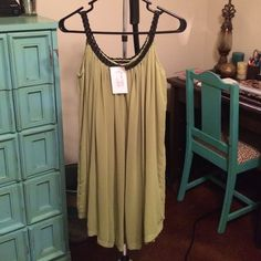 Green Braided Strap Dress This dress is super flattering and easy to wear. Tags still attached, never worn AnM Dresses Midi