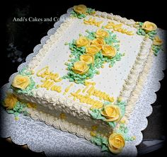 Christening cake with yellow buttercream roses and cross.  1/4 sheet single layer.