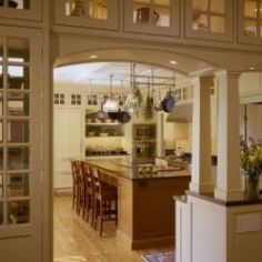 Great idea if removal of walls not possible due to lack of support; love the top cabinetry with windows on both sides.
