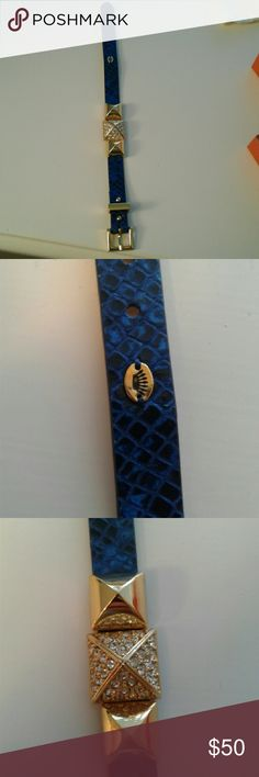 Juicy couture bracelet Blue snake with gold. I have worn it maybe 3 times but it is super great condition. No crystals are missing or snake scales. Juicy Couture Jewelry Bracelets