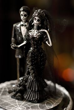 Halloween Wedding cake topper I bought this for our Hallowedding 6 years ago on Etsy, I don't recall the artists name.
