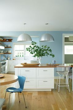 Cabinet Color Ideas & Inspiration A contemporary kitchen with white cabinets and light blue painted walls is bright and airy.With With or WITH may refer to: Paint For Kitchen Walls, Blue Kitchen Cabinets, Kitchen Cabinet Colors, White Cabinets, Kitchen With Blue Walls, Paint Colors For Kitchen, Best Kitchen Colors, Pastel Kitchen, New Kitchen