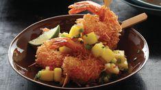 Les crevettes parfumées à la noix de coco et accompagnées de salsa à la mangue…