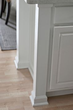 Add posts to sides of cabinets for a custom look