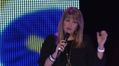 Pastor Bobbie Houston speaking wisdom from the Colour 2012 Conference platform.