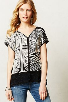 Hajna Tee - anthropologie.com. Size small. Can look boxy so I wear with skinny black jeans.