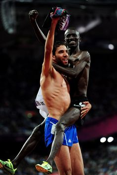 Silver medalist Mahiedine Mekhissi-Benabbad of France celebrates with gold medalist Ezekiel Kemboi of Kenya celebrate after the Men's 3000m Steeplechase on Day 9 of the London 2012 Olympic Games at the Olympic Stadium on August 5, 2012 in London, England. (Photo by Stu Forster/Getty Images)