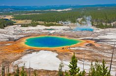 29 Surreal Places In America You Need To Visit Before You Die This natural pool of rainbow-like colors is the largest hot spring in the U.S. and the third largest in the world. It's located in Yellowstone National Park, which also has other great sights to see such as Morning Glory Pool, Old Faithful, and the Grand Canyon of the Yellowstone.