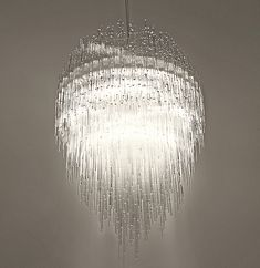 A unique designer 'gallery' chandelier characterised by the 'beauty' of plexiglass ice crystals. The light is wonderfully diffused through the use of over 3.600 tubes; the light effect in keeping with the principle of light refracting through water. The 'illumination' created being both brilliant and natural. Part of a high profile collection of lighting with emphasis on highly specified materials and methodical production methods meticulously hand crafted by master craftsmen. A sculptural…
