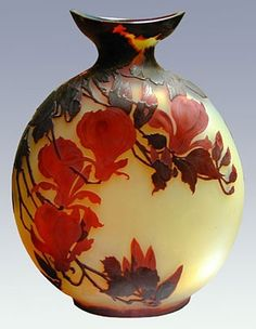 Émile Gallé | Large glass bottle decorated with layered red magnolias.
