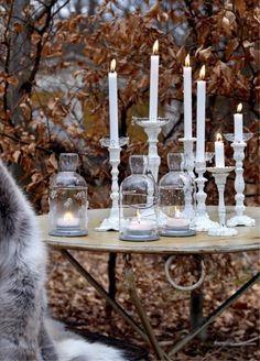 Rustic table. Candlesticks. Votives. Leaves.