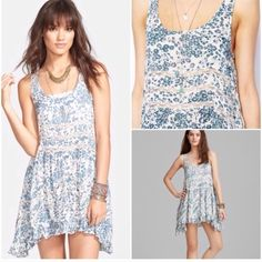 Voile lace trapeze Ivory blue floral combo. This is also brand new never been worn. Price is firm on poshmark. Free People Dresses Mini
