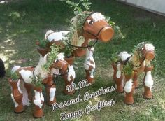 Flower pot horse family. I made LG regular size, and two smaller. Caramel and white paints :-D