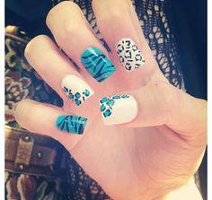Love these zebra cheetah nails