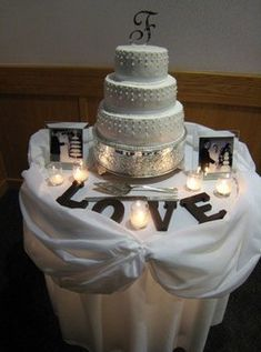 So doing this, love the parents pictures & tea lights. Want a word just not sure what...