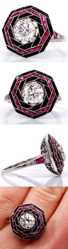 Let's go old school with this Art Deco diamond and ruby ring which is handcrafted in solid platinum. The round brilliant center diamond weighs 1.25 cts., and is accented perfectly by an array of 20 French-cut rubies (0.5 cts.) and 24 genuine black onyx stones. And let's not forget the diamond accents that trail down the ring's shank. (Thanks to Dover Jewelry for the photos and info.) www.diamonds.pro