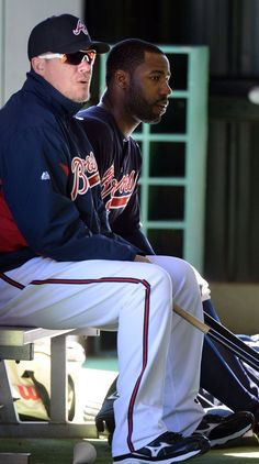 Atlanta Braves' retired third baseman Chipper Jones (left) sits with Atlanta Braves outfielder Jason Heyward in a batting cage during the third full squad workout at Champion Stadium in the ESPN Wide World of Sports Complex in Lake Buena Vista, Fl., on Sunday, Feb. 17, 2013.