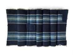 Japanese antique hand loomed ikat fabric from Meiji or Taisho Era. Fabric: 100% hand loomed, homespun cotton. Indigo dyed medium weight fabric. Color: dark indigo, medium indigo, and white  Its in excellent antique boro condition. Perfect for fashion, home decor and interior design project. Approximate size in centimeter: 34cm wide x 156cm long  *Please note that the actual color may look slightly different from the images shown on your screen. **Also note that vintage & antique items ma...