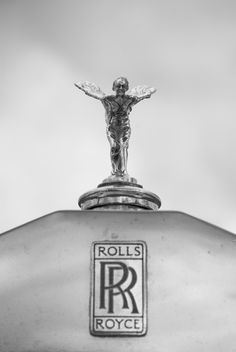 spirit of ecstasy by Marc Melander - Uncropped detail of a Rolls Royce 'Spirit of Ecstasy' emblem.