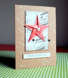 Handmade Christmas card with origami star and patterned paper