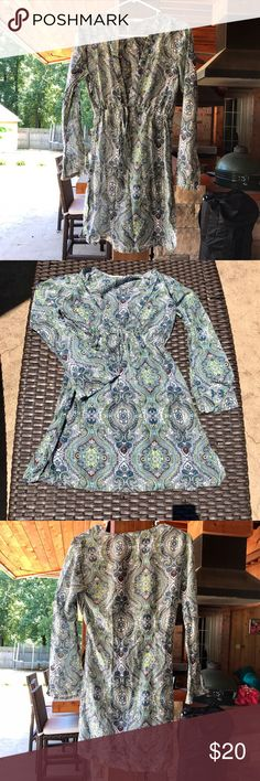 Athleta paisley swim cover up A cute green and teal swimsuit cover up from Athleta with a paisley print. In good used condition. All listings are from a smoke free home and reasonable offers are accepted! Athleta Swim Coverups