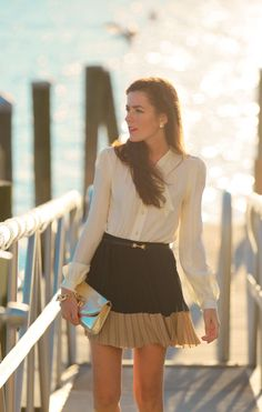 I like the frilly look of the blouse. I like the color block of the skirt. I would be uncomfortable with the skirt length.