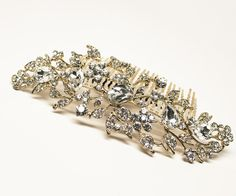 Rhinestone floral bridal hair comb featuring high quality rhinestones set in a gold setting in a romantic and elegant flower design by Hair Comes the Bride.