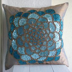 Pillow Cover is made on a beautiful two tone blue rust color in Art Silk Dupioni Fabric embroidered intricately with different color sequins and